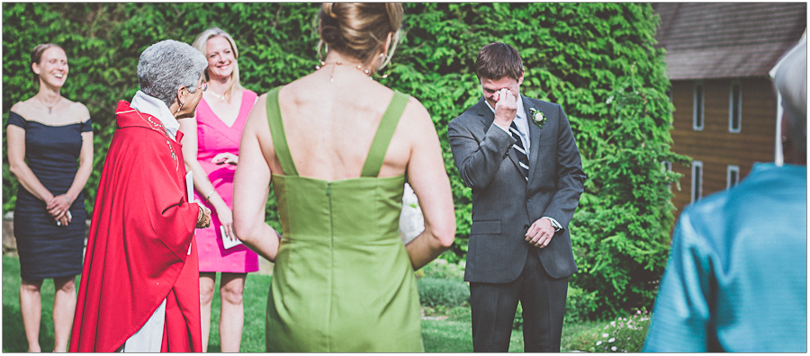 groom crying at wedding alter
