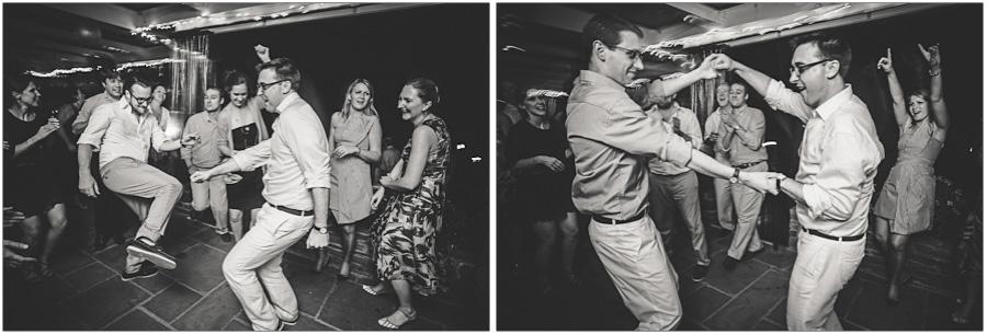 the same sex couple enjoys their wedding reception