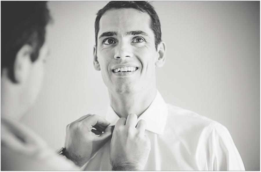groom prep getting help with tie