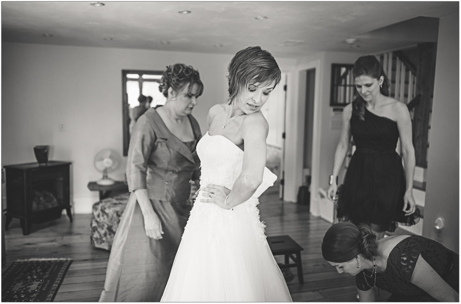 bride getting into her dress at borsari gallery